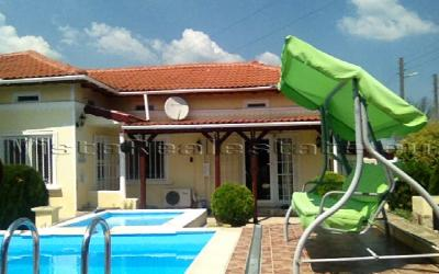 Spacious house with a pool near a town